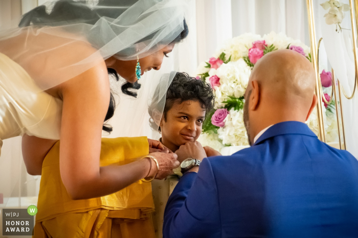 The wedding couple include the son of the groom in the marriage ceremony    Plymouth Manor