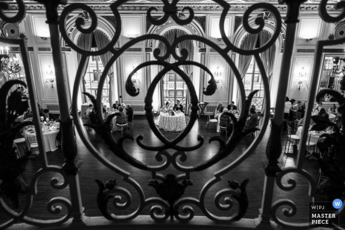 Colony Club, Detroit, MI - Picture through the Wrought Iron Balusters of the Sweetheart table during the reception