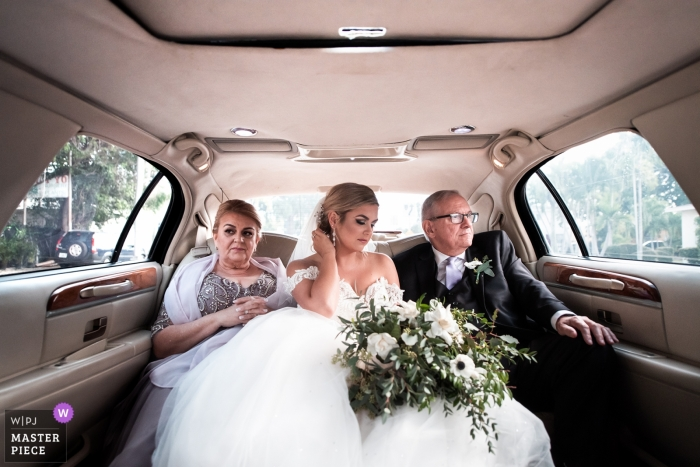 The Epic Hotel Miami FL wedding photo of the solemn atmosphere before the ceremony in the limo with bride and parents.
