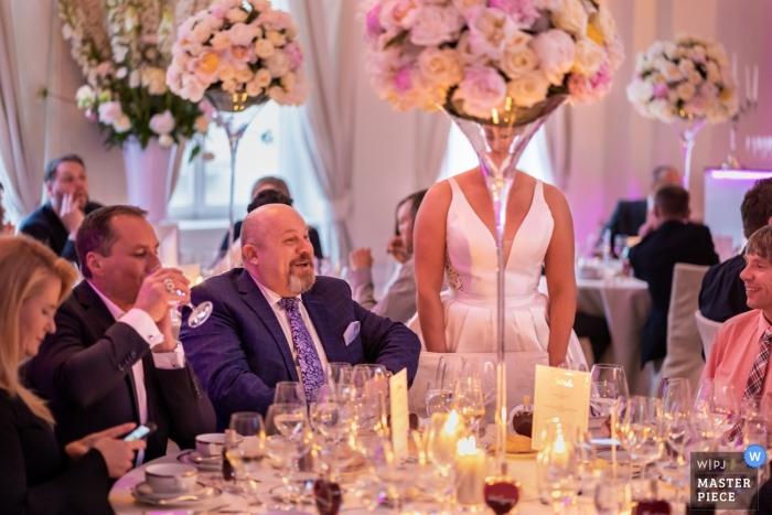 Wedding photo of Bride flowers head at a reception table at LA8, Baden-Baden