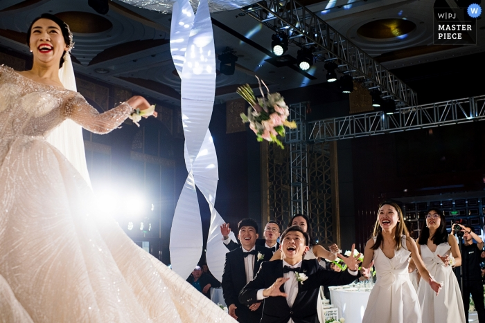 Throwing wedding bouquet at the China Shandong reception.