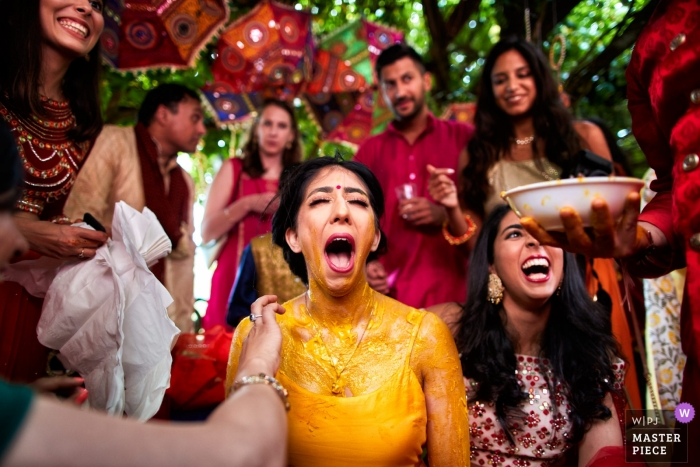 Il Ciocco Resort - Barga Tuscany - Wedding image of the bride doing the vidhi ceremony (with the yellow paste)