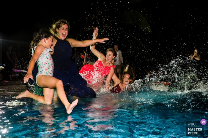 Ho Chi Minh wedding photographer captured this photo of the wedding guests jumping into the pool at the wedding reception.