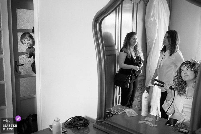 Varazze, Italy - Wedding photo of the bride getting hear hair done during getting ready