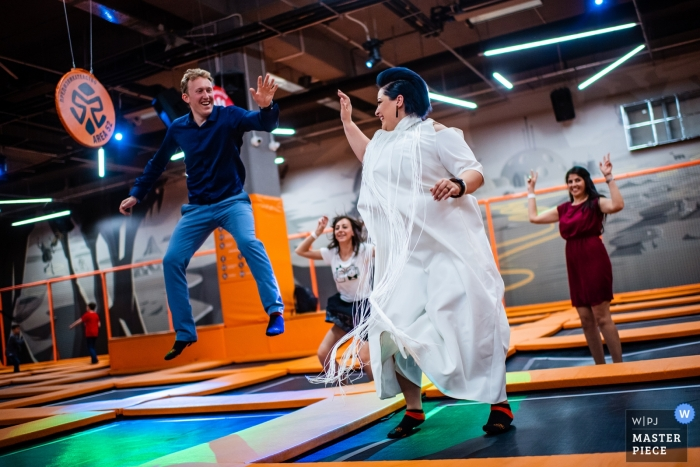 Wedding Photography of the Bride and Groom Jumping In The Trampoline Zone - Niagara, Sofia, Bulgaria