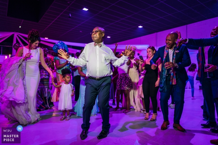 Chartres Wedding Reception Photography - Image of the dancing Grandfather on Fire under purple lighting