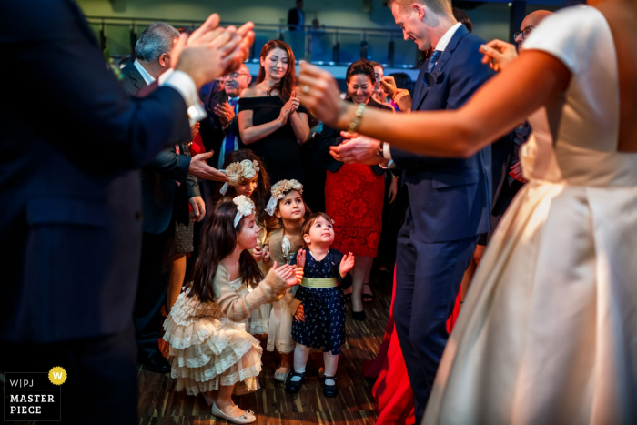 Hengelo - Waarbeek wedding reception photography | The kids learning how to dance and clap from the bride and groom