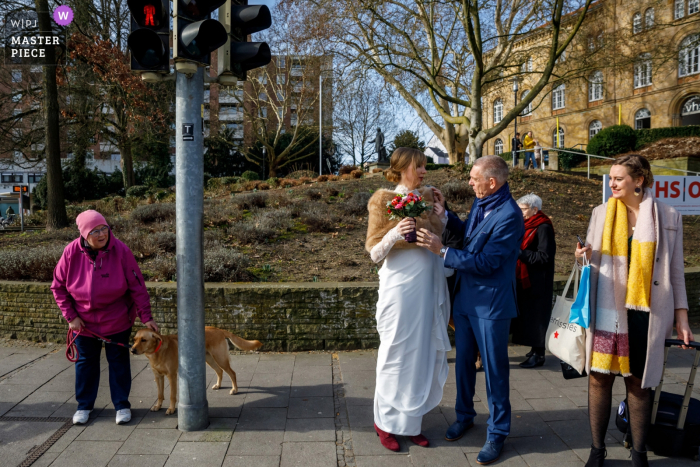 Osnabruck, NL wedding photographer   Picture of the Bridal party crossing the street on their way to the groom
