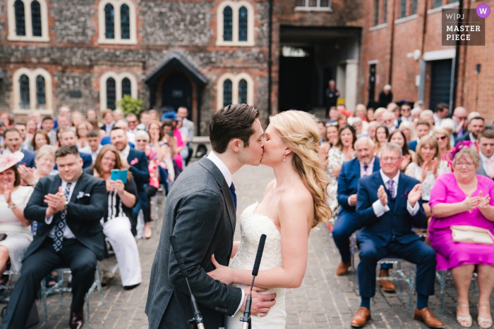 Bombay Sapphire Gin Distillery, Hampshire, UK Wedding Ceremony Photography - The first kiss for the bride and groom