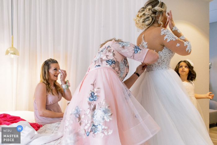 Chateau de Chapeau Cornu Wedding Photographer - Picture of a Crying bride and crying bridesmaid