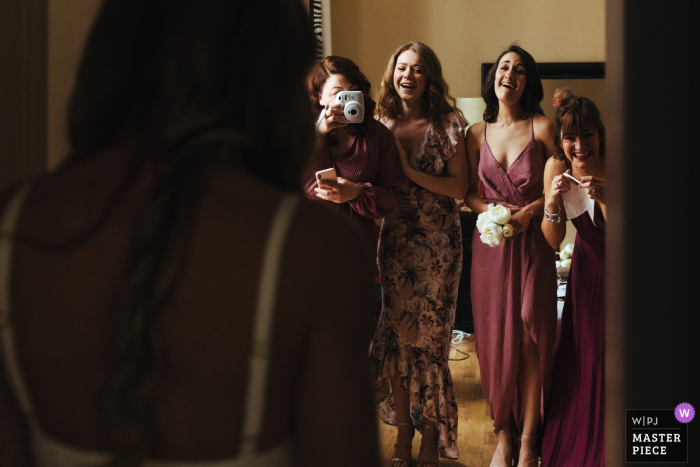 Hotel Grand Cavour, Florence, Italy Wedding Photographer - Image taken as bridesmaids see bride in her dress for the first time