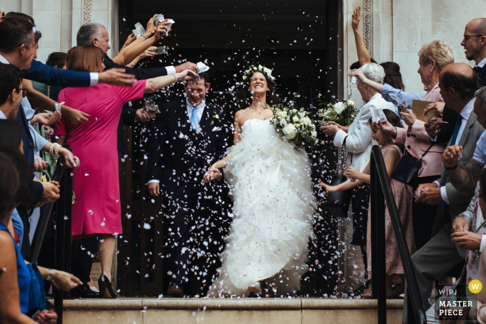 Islington Town Hall wedding photograph showing the bride and groom under confetti on the steps of town hall