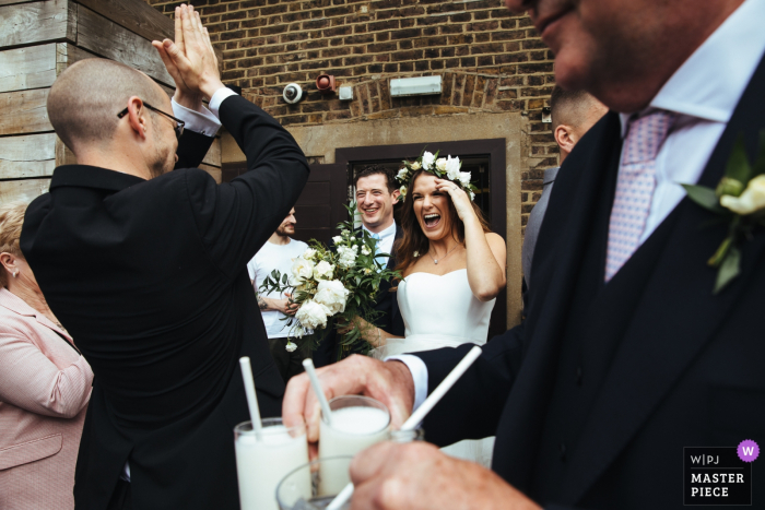 Vivo Islington wedding day photography showing the bride and groom arrive at reception