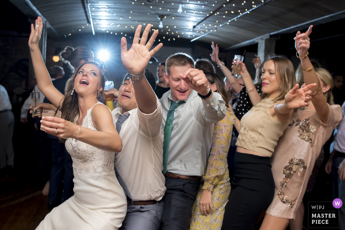 Kolo Klub Wedding Reception Photography showing bride and guests dancing at the reception