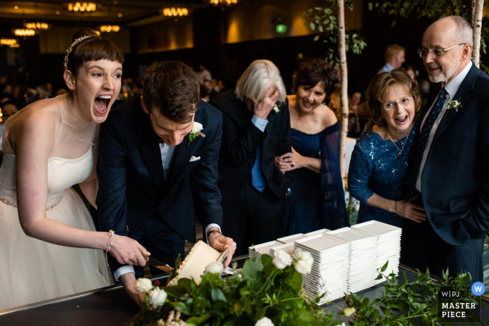 Edgewater Hotel Wedding Reception Photos - The cake fell down during the the cake cutting and everyone is laughing - Madison, WI wedding photography