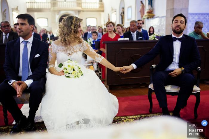 Igreja de S. Miguel de Vila das Aves - Portugal   Ceremony Photography showing the godfather's emotion