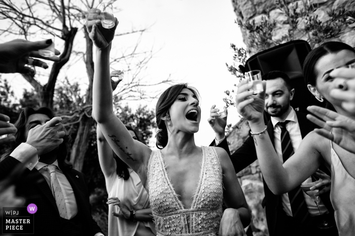 Acqua Petra Resort Wedding Photography - the bride's toast with friends