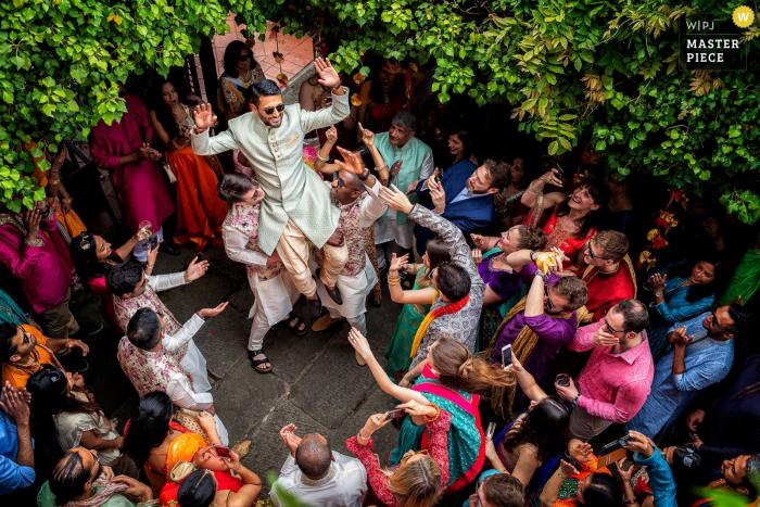 Il Ciocco Resort - Barga - Tuscany   Wedding Photography of Indian traditional dancing with groom