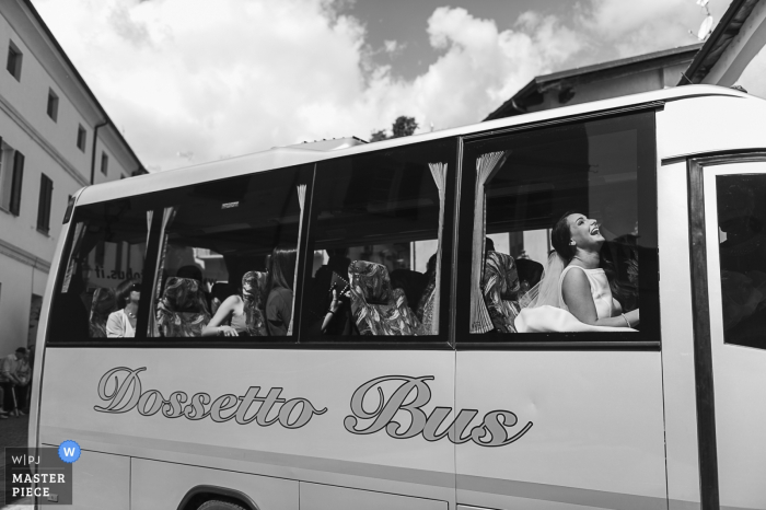 Barge (Cuneo) wedding photography of bridal party arriving on the bus