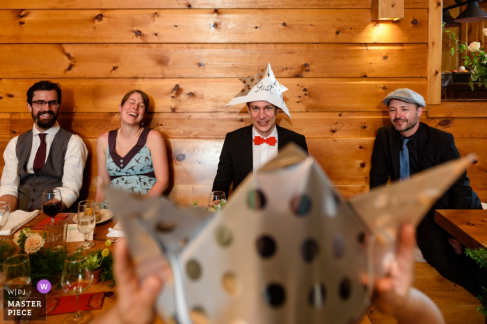 Laurentides, Quebec - Chalet Wedding Photo of a couple looking at each other with Japanese paper wedding hats