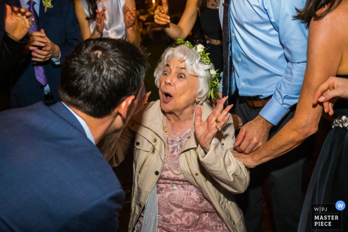 """Wedding Photography from Arroyo Trabuco Golf Club, Mission Viejo, California - The 90-year-old grandmother of the bride - also a """"flower girl"""" - is surrounded by her children and is surprised to find herself on the dance floor."""