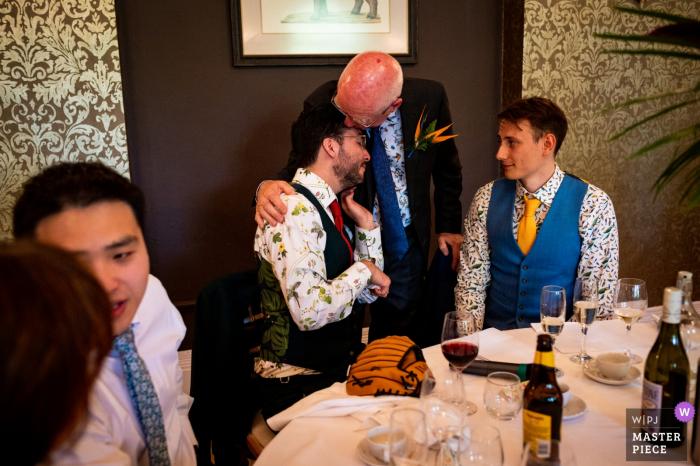 ZOO de Bristol, Royaume-Uni Photographie de la réception de mariage montrant le père du marié