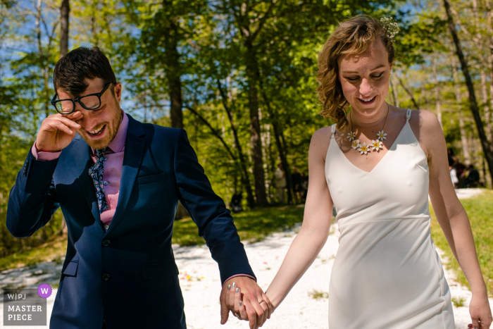 Deerfields Campground wedding photo of the Bride and Crying Groom Post-Ceremony - Madison, WI wedding photographer