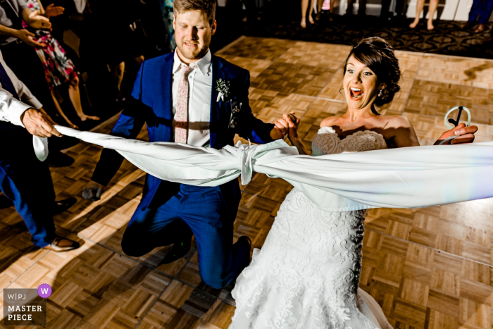 Bride and Groom Epic Limbo on the Dance Floor at Minneapolis Golf Club, Minneapolis, MN