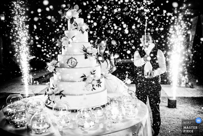 """Antico borgo della rocca, Rocca Susella, PV, Italy Photographer: """"The cake cutting, the groom shook the prosecco before to open it, I had to clean all my lenses and gear but I got the image"""""""