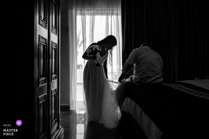 Velas Vallarta Resort, Puerto Vallarta, Mexico. - Bride's father fixing her dress.