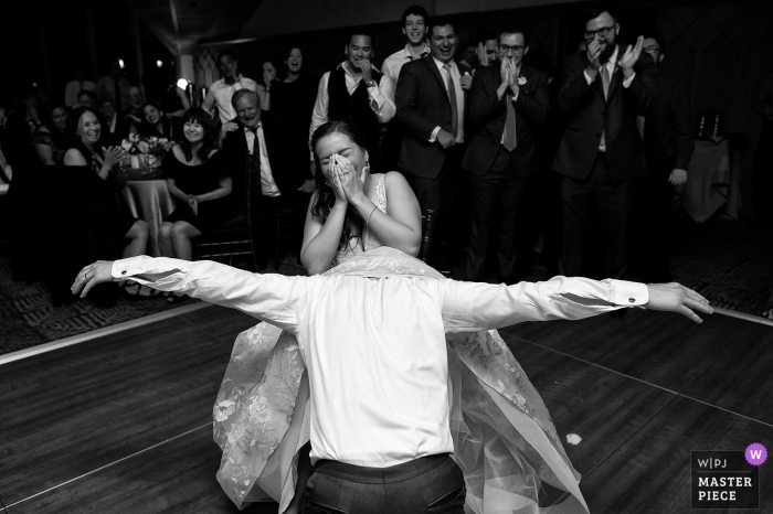 Reception Photography at the Edgewood, Lake Tahoe, NV - The groom retrieving the garter hands-free.