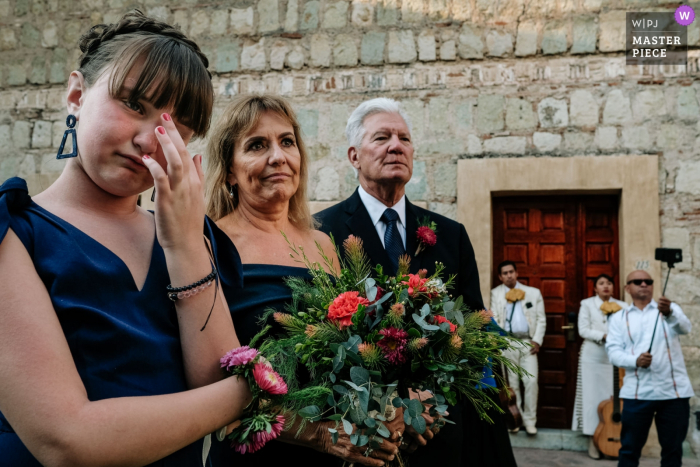 Quinta Real, Oaxaca, Mexico Wedding Day Photography | Bride and groom's daughter at the ceremony and her uncle with his selfie stick