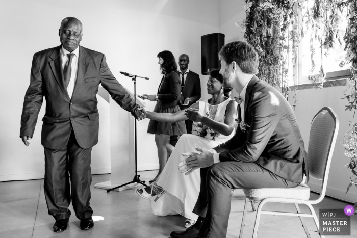 Château d'Azy photography of emotion between father and bride during wedding ceremony