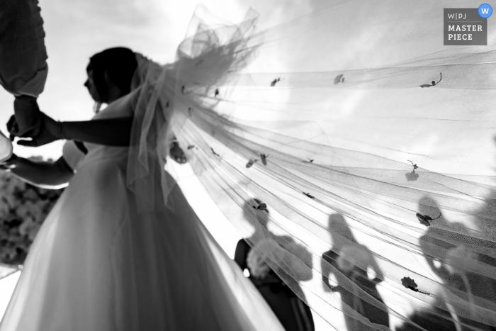 Phuket, Thailand Bridal's dress image from the outdoor wedding ceremony