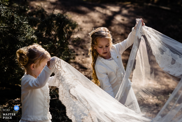Netherland, Bergen-op-Zoom Wedding Photography Showing the Helping hands of bride's little sisters