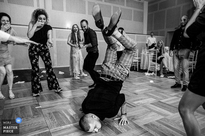 Black and white photo of some break-dance action on the dance floor at Hotel Novotel