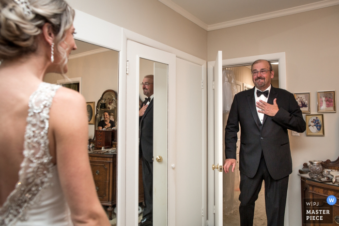 Toronto, Ontario - The Eglinton Grand Photography - The father and bride first look. The wedding party were at the other side of the room, but you can catch one of the bridesmaids in the small mirror.