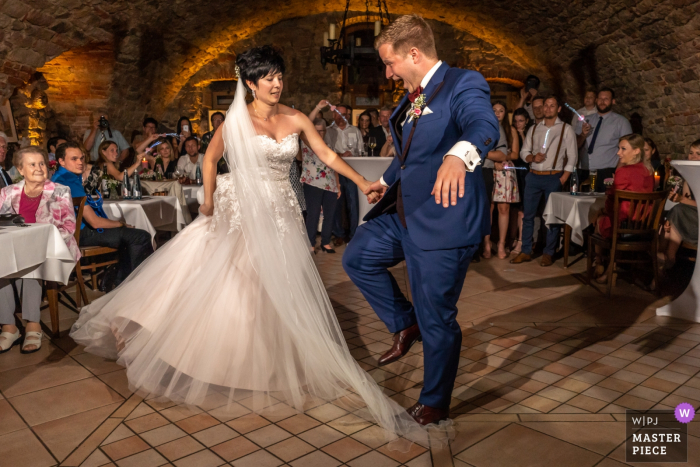 Zell am Harmersbach Wedding Venue Photographer - Groom stepping on the bride's dress during the first dance