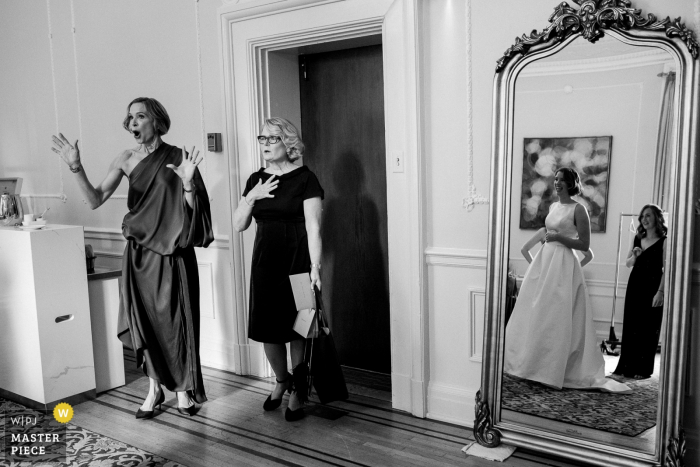 Vancouver Club, BC Wedding Photography showing bride's mom and mother in law seeing her dress for first time.