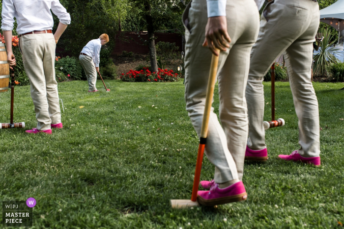 Photo of the wedding party playing lawn games at a Linden Gardens, Penticton wedding reception.