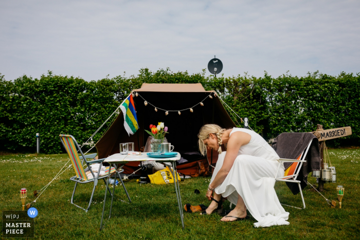 Therschelling wedding photograph of the bride getting ready at the camping tent