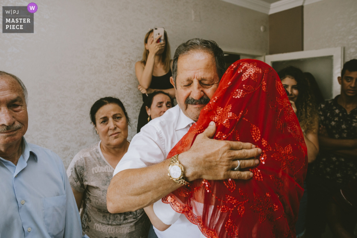 mersin hilton hotel turkey wedding photography of the bride saying goodbye to her father