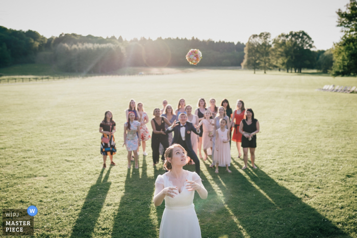 Domaine de la Butte Ronde Wedding Photography of Suspended flowers thrown by the bride outside
