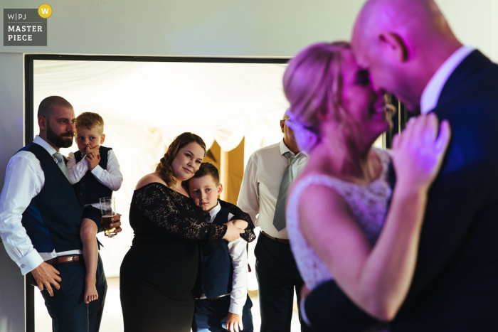 The Gardens, Yalding Wedding Photos | Couple first dance whilst family look on