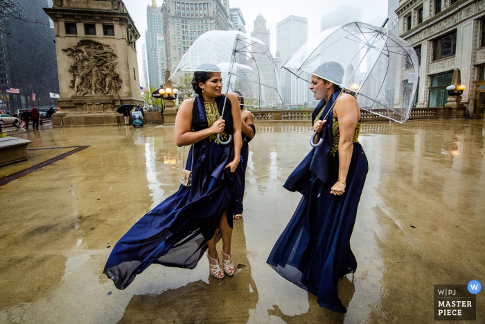 floating gallery chicago wedding photo of bradesmaids standing in the rain
