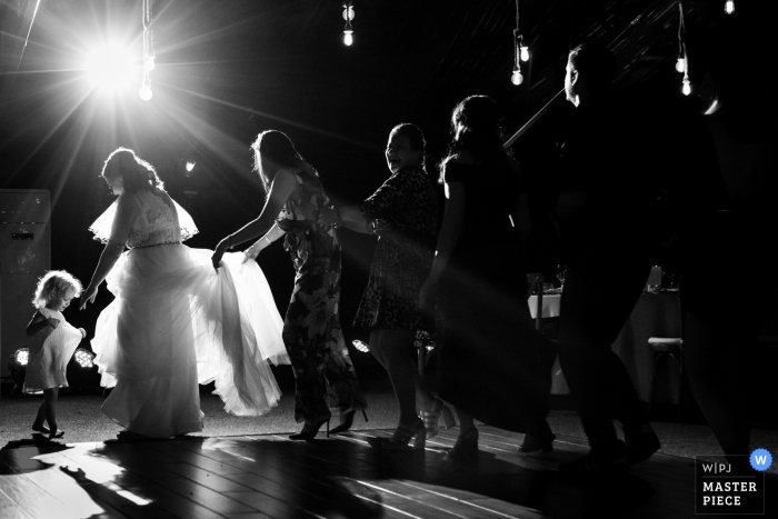 Photo of the Bride and guest dancing during the reception party at Padurile Regale