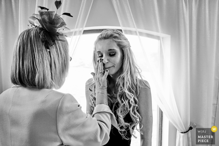 Bordesley Park Wedding Day Photography   Bride's mother wiping away the bride's wedding day tears