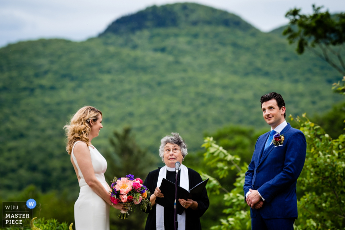 Marble House Project (Dorset, Vermont) Wedding Photos - Officiant reacts to rain beginning to fall during the ceremony. VT and CT wedding photography.