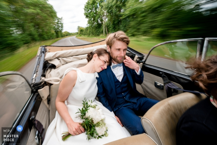 Bride and groom on their way to the ceremony at Domaine des Forges