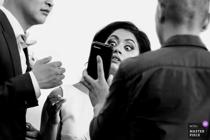 BELCROFT ESTATE&EVENT CENTRE - Wedding Photography - The bride was looking at something on the phone